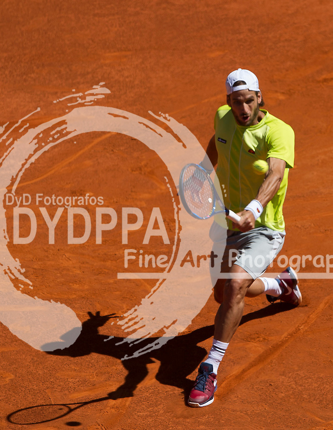 Spanish tennis player Feliciano Lopez returns the ball