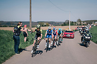 Jack Haig (AUS/Michelton-Scott) catching his last bidon while leading the race in the last local lap<br /> <br /> 82nd Flèche Wallonne 2018 (1.UWT)<br /> 1 Day Race: Seraing - Huy (198km)
