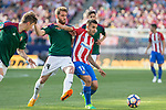 Miguel Olavide and Fausto Tienza of Club Atletico Osasuna competes for the ball with Angel Correa of Atletico de Madrid during the match of La Liga between  Atletico de Madrid and Club Atletico Osasuna at Vicente Calderon  Stadium  in Madrid, Spain. April 15, 2017. (ALTERPHOTOS / Rodrigo Jimenez)