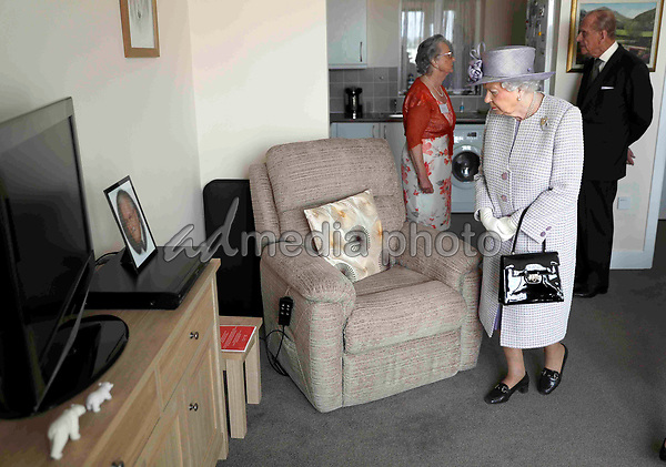 11 April 2017 - Queen Elizabeth II and Prince Philip Duke of Edinburgh view a flat belonging to Pauline Stainsby during a visit to Priory View, an independent living scheme for older residents, in Dunstable, Bedfordshire. Photo Credit: ALPR/AdMedia