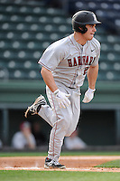 Right fielder Brandon Kregel (21) of the Harvard Crimson bats in a game against the Michigan State Spartans on Saturday, March 15, 2014, at Fluor Field at the West End in Greenville, South Carolina. Michigan State won, 4-0. (Tom Priddy/Four Seam Images)