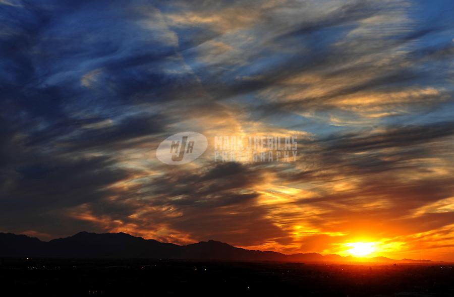 sunset sun sky clouds dusk Phoenix Arizona weather storm chaser chasing mountains sun