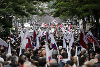 Pictured: Protesters with flags on the streets of central Athens, Greece. Wednesday 17 May 2017<br /> Re: Clashes between anti fourth memorandum protesters and riot police during 24 hour strike in Athens, Greece