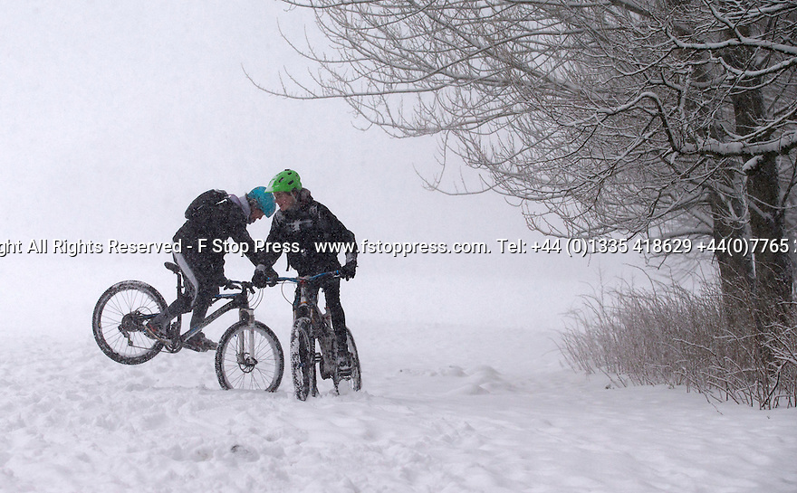 29/01/15<br /> <br /> Young lads play on their mountain bikes in the snow.<br /> <br /> Heavy snowfall results in multiple accidents, stranded vehicles and traffic chaos as the wintery weather does its best to shut down theDerbyshire Peak District town of Buxton.<br /> <br /> All Rights Reserved - F Stop Press.  www.fstoppress.com. Tel: +44 (0)1335 418629 +44(0)7765 242650