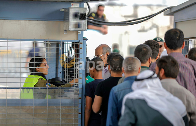 Palestinians make their way through Qalandia checkpoint to attend the second Friday prayer of the holy fasting month of Ramadan in Jerusalem's Al-Aqsa mosque, near Ramallah in the occupied West Bank, on May 25, 2018. Ramadan is sacred to Muslims because it is during that month that tradition says the Koran was revealed to the Prophet Mohammed. The fast is one of the five main religious obligations under Islam. Muslims around the world will mark the month, during which believers abstain from eating, drinking, smoking and having sex from dawn until sunset. Photo by Eyad Jadallah