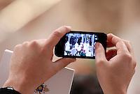 Papa Francesco celebra la Santa Messa del Crisma nella Basilica di San Pietro, Citta' del Vaticano, 28 marzo 2013..A priest uses his mobile phone to take pictures as Pope Francis celebrates the Chrism Mass in St. Peter's Basilica at the Vatican, 28 March 2013..UPDATE IMAGES PRESS/Riccardo De Luca..STRICTLY ONLY FOR EDITORIAL USE