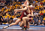 March 21 2009      Craig Brester (red, in front) from Nebraska battles Jake Varner (maroon) from Iowa State in the 197 pound weight class in the championship round of the NCAA Division I  Wrestling Championships which were held March 19 through March 21, 2009 at the Scottrade Center in downtown St. Louis, Missouri.  ..         *******EDITORIAL USE ONLY*******