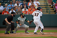 Delmarva Shorebirds Adley Rutschman (37) at bat in front of umpire Mitch Leikam and catcher Grant Koch during a South Atlantic League game against the Greensboro Grasshoppers on August 21, 2019 at Arthur W. Perdue Stadium in Salisbury, Maryland.  Delmarva defeated Greensboro 1-0.  (Mike Janes/Four Seam Images)