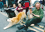 Ralph keeps the rhythm on his bongo as his canine friend relaxes during the Fleadh Nua in Ennis - June 4, 1999. Photograph by John Kelly