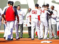 Derek Jeter #2 of the New York Yankees is greeted by David Ortiz #34 of the Boston Red Sox along with the rest of the members of the Red Sox during pregame ceremonies at Fenway Park in Jeter's final career game on September 27, 2014 in Boston, Massachusetts. (Photo by Jared Wickerham for the New York Daily News)