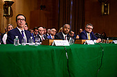 """From left to right; United States Secretary of the Treasury Steven T. Mnuchin, US Secretary of Housing and Urban Development (HUD) Ben Carson, and Mark A. Calabria, Ph.D., Director, Federal Housing Finance Agency, testify during a hearing before the US Senate Committee on Banking, Housing, and Urban Affairs entitled """"Housing Finance Reform: Next Steps"""" on Capitol Hill in Washington, DC on Tuesday, September 10, 2019.<br /> Credit: Ron Sachs / CNP"""