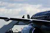 United States President-elect Donald Trump boards his plane at Laguardia Airport in New York, New York on his way to Louisiana and Michigan, December 9, 2016.<br /> Credit: Aude Guerrucci / Pool via CNP