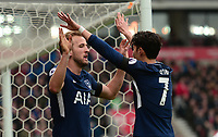 Harry Kane of Tottenham  celebrates with team mate Heung-Min Son of Tottenham after he scores to make it 2-1 during the EPL - Premier League match between Chelsea and West Ham United at Stamford Bridge, London, England on 8 April 2018. Photo by PRiME Media Images.