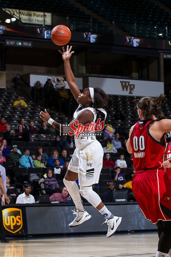 Amber Campbell (2) of the Wake Forest Demon Deacons floats a shot towards the basket during first half action against the Louisville Cardinals at the LJVM Coliseum on January 11, 2015 in Winston-Salem, North Carolina.  The Cardinals defeated the Demon Deacons 79-68.  (Brian Westerholt/Sports On Film)
