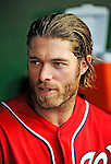 9 July 2011: Washington Nationals outfielder Jayson Werth chats in the dugout during a game against the Colorado Rockies at Nationals Park in Washington, District of Columbia. The Nationals were edged out by the Rockies 2-1, dropping the second game of their 3-game series. Mandatory Credit: Ed Wolfstein Photo
