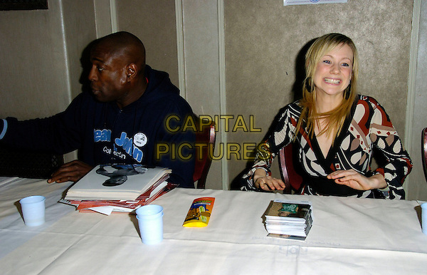 FRANK BRUNO & KELLIE SHIRLEY.At The Mad Hatters Tea Party, Grosvenor House, Park Lane, London, England, January 28th 2007..half length sitting signing autographs photos kelly.CAP/CAN.©Can Nguyen/Capital Pictures