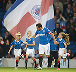 Rangers captain Lee McCulloch leads out the match mascots at kick-off