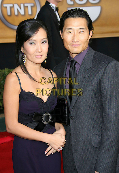 DANIEL DAE KIM & GUEST.12th Annual Screen Actors Guild Awards 'SAG' held at the Shrine Auditorium, Los Angeles, California, USA,.January 29th, 2006.Photo: Zach Lipp/AdMedia/Capital Pictures.Ref: ZL/ADM.half length .www.capitalpictures.com.sales@capitalpictures.com.© Capital Pictures.