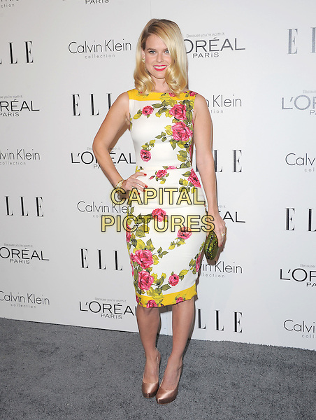 Alice Eve.18th Annual ELLE Women in Hollywood celebration held at The Four Seasons in Beverly Hills, California, USA..October 17th, 2011.full length white pink green sleeveless dress yellow clutch bag floral print hand on hip.CAP/RKE/DVS.©DVS/RockinExposures/Capital Pictures.