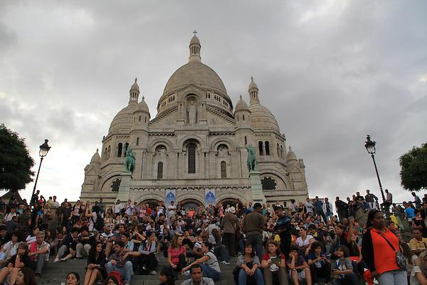 Visitors at Sacre-Coeur Basilica in Paris, France.