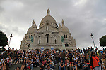 Visitors at Sacre-Coeur Basilica in Paris, France.