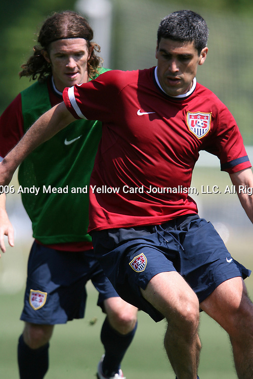 Claudio Reyna (r) is defended by John O'Brien (behind) on Wednesday, May 17th, 2006 at SAS Soccer Park in Cary, North Carolina. The United States Men's National Soccer Team held a training session as part of their preparations for the upcoming 2006 FIFA World Cup Finals being held in Germany.