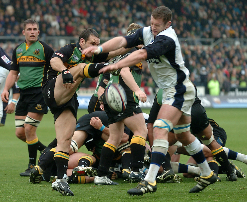 Photo. Richard Lane..Northampton Saints v Sale Sharks. 16/10/2004..Jason White charges down a Mark Robinson clearance.