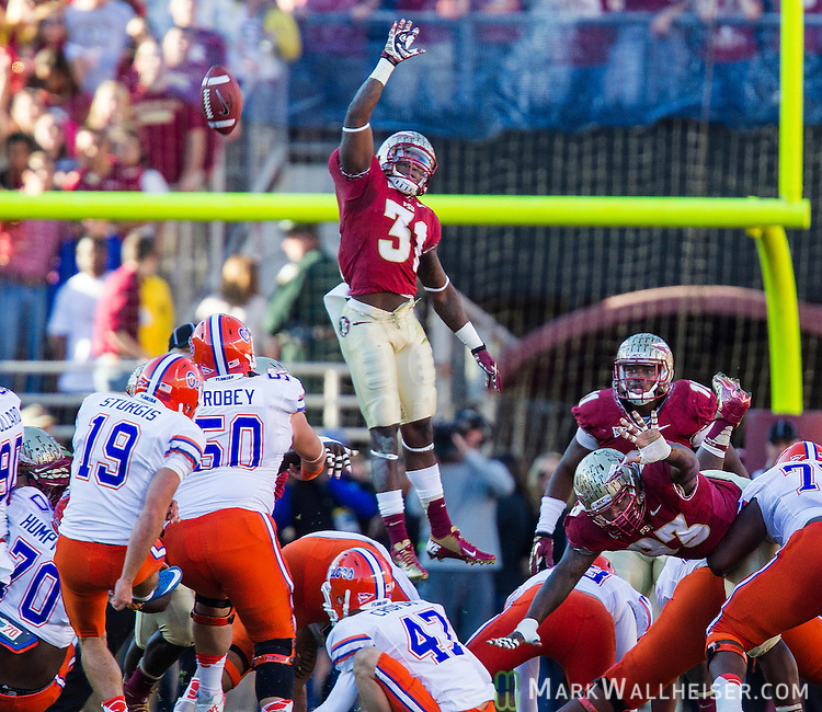 FSU defensive back Terrence Brooks (31) leaps in an attempt to block a Caleb Sturgis (19) 39 yard field goal in the first quarter.   The 6th ranked University of Florida Gators defeated the 10th ranked Florida State Seminoles 37-26 at Doak S. Campbell Stadium in Tallahassee, Florida Nov. 24, 2012.