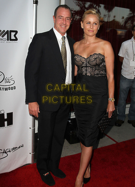 Michael Lohan & guest.The World's Most Beautiful Magazine Launch Event held at Drai's in Hollywood, California, USA..August 10th, 2011.full length black lace corset strapless suit jacket skirt.CAP/ADM/KB.©Kevan Brooks/AdMedia/Capital Pictures.