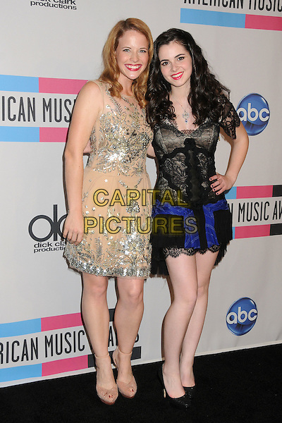 Katie Leclercn & Vanessa Marano.2011 American Music Awards - Press Room held at Nokia Theatre LA Live, Los Angeles, California, USA..November 20th, 2011.ama amas ama's full length beige silver sequins sequined dress hand on hip beads beaded blue black lace  .CAP/ADM/BP.©Byron Purvis/AdMedia/Capital Pictures.