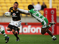 Manawatu winger Lote Raikabula tackles Fa'atonu Fili. Air NZ Cup - Wellington Lions v Manawatu Turbos at Westpac Stadium, Wellington, New Zealand. Saturday 3 October 2009. Photo: Dave Lintott / lintottphoto.co.nz