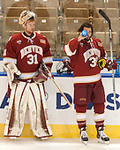 Evan Cowley (DU - 31), Grant Arnold (DU - 39) - The Boston College Eagles defeated the University of Denver Pioneers 6-2 in their NCAA Northeast Regional semi-final on Saturday, March 29, 2014, at the DCU Center in Worcester, Massachusetts.