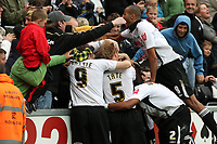Pictured: (L-R) Craig Beattie, Alan Tate, Ashley Williams and Darren Pratley of Swansea City in action <br /> Re: Coca Cola Championship Swansea City Football Club v Queens Park Rangers (QPR) at the Liberty Stadium, Swansea, south Wales. Saturday 03 October 2009