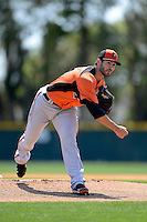 Baltimore Orioles pitcher Jake Arrieta #23 during a minor league Spring Training game against the Minnesota Twins at Buck O'Neil Complex on March 26, 2013 in Sarasota, Florida.  (Mike Janes/Four Seam Images)