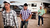 Dodge City, Kansas, USA, August 2011:.Mexican immigrants at horse racing event, one of the favourite past time for immigrant community. Many hispanic immigrants, mainly Mexican and Salvadorian came here to work at huge Cargill and National Beef meatpacking plants, each of which kills and processes 5-6 thousand cattle a day. Kansas dominates American beef industry, by producing one quarter of all beef in the USA, while being heavily dependent on cheap immigrant labour..(Photo by Piotr Malecki / Napo Images)..Dodge City, Kansas, Stany Zjednoczone, Sierpien 2011:.Meksykanscy emigranci podczas wyscigow konnych, jednego z ulubionych sportow tutejszej spolecznosci emigrantow. Duzo emigrantow z Meksyku i Salwadoru pracuje w wielkich zakladach miesnych, ktore zabijaja i przerabiaja po 5-6 tysiecy sztuk bydla dziennie. Stan Kansas zdominowal rynek wolowiny w Stanach Zjednoczonych, produkujac jedna czwarta calej amerykanskiej wolowiny. Amerykanski przemysl miesny jest bardzo uzalezniony od taniej sily roboczej, ktora daja emigranci..Fot: Piotr Malecki / Napo Images.