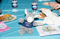 "A stuffed donkey toy wearing a shirt reading ""Democracy in Action"" is seen on a table as Democratic presidential candidate and Congressional Representative Eric Swalwell (D-CA 15th) speaks at the Milford Democrats' Potluck Supper at the Unitarian Universalist Congregation Church in Milford, New Hampshire, USA, on Sat., Apr. 6, 2019. Swalwell is running primarily on gun control issues."