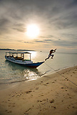 INDONESIA, Flores, Riung, Al Itchan a 15th generation Flores local jumps onto the sand and off of his boat at Rutong island