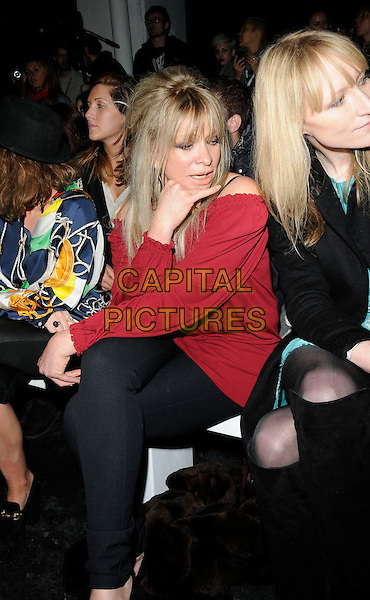 JO WOOD .At the House of Holland a/w 2011 Fashion Show during London Fashion Week, Old Sorting Office, London, England, UK, February 19th 2011..half length red off the shoulder top black sitting front row  .CAP/CAN.©Can Nguyen/Capital Pictures.