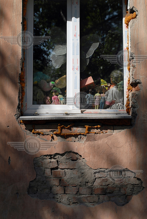 A toy collection viewed through a suburban Kyzyl window.