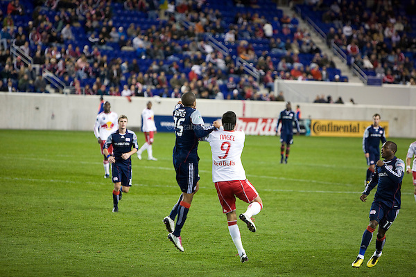 New England's Darrius Barnes and New York's Juan Pablo Angel fight for the ball as the New York Red Bulls play their final match of the season against the New England Revolution at Red Bull Arena in Harrison, New Jersey on 21 October 2010.