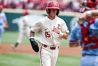 NWA Democrat-Gazette/CHARLIE KAIJO Arkansas Razorbacks infielder Casey Martin (15) scores during game two of the College Baseball Super Regional, Sunday, June 9, 2019 at Baum-Walker Stadium in Fayetteville. Ole Miss forces a game three with a 13-5 win over the Razorbacks