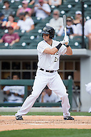 Tyler Colvin (26) of the Charlotte Knights at bat against the Norfolk Tides at BB&T BallPark on June 7, 2015 in Charlotte, North Carolina.  The Tides defeated the Knights 4-1.  (Brian Westerholt/Four Seam Images)