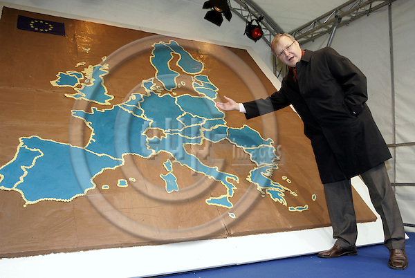 BRUSSELS - BELGIUM - 14 DECEMBER 2006 -- Accession ceremony of Bulgaria and Romania to the EU. -- Olli REHN, the Finnish EU-Commissioner for Enlargement in front of the European map made of ginger bread. -- PHOTO: JUHA ROININEN / EUP-IMAGES.20061214.hsyo.yo