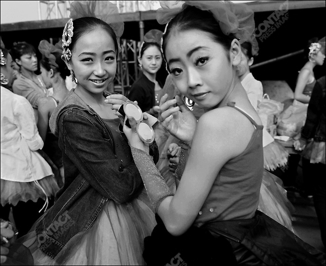 Girls prepare for the opening ceremony, Pingyao photo festival, 2003