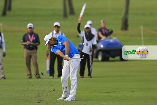 Victor Dubuisson (FRA) Team Europe plays his 2nd shot on the 1st hole during Match 1 of Friday's Fourball Matches of the 2016 Eurasia Cup presented by DRB-HICOM, held at the Glenmarie Golf &amp; Country Club, Kuala Lumpur, Malaysia. 15th January 2016.<br /> Picture: Eoin Clarke | Golffile<br /> <br /> <br /> <br /> All photos usage must carry mandatory copyright credit (&copy; Golffile | Eoin Clarke)