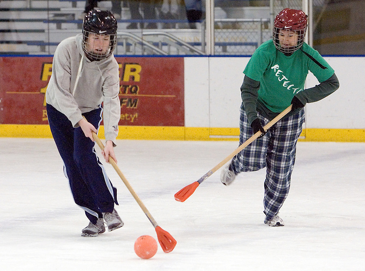 "(**I'M STILL DOUBLE CHECKING NAMES: 11/6/06) ""Balls to the Wall"" team member Andrea Yutzy (left) and ""Rejects"" team member Elizabeth Bowlus (right) compete during an intramural broomball game on Wednesday, 11/1/06. ""Balls to the Wall"" won the championship for the women's league in 2006, their third year in a row as champs."