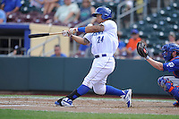 Cheslor Cuthbert #24 of the Omaha Storm Chasers swings against the Las Vegas 51s at Werner Park on August 17, 2014 in Omaha, Nebraska. The Storm Chasers  won 4-0.   (Dennis Hubbard/Four Seam Images)