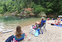 Come on in, the water's fine at the McKissic Creek swimming hole in Bentonville. Swimming holes along the Ozark's streams offer cool relief from the summer heat, along with gravel beaches perfect for a picnic or just relaxing. <br />(NWA Democrat-Gazette/Flip Putthoff)