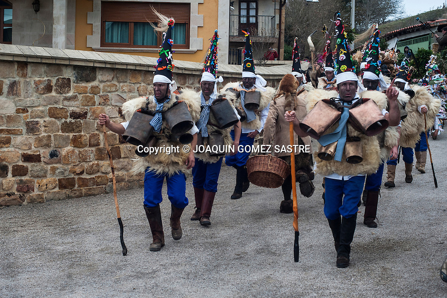 The zarramacos walking with their campanos the village streets of Silio (Cantabria) during the first carnival of the year.