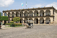 Horse and carriage in front of Palacio de Ayuntamiento or Town Hall facing the Parque Central, Antigua, Guatemala. Antigua is a UNESCO World heritage site...
